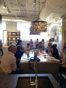 Louis Postel in white shirt leading a writing workshop at the Boston Design Center last year